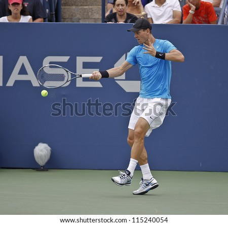NEW YORK - SEPTEMBER 3: Tomas Berdych of Czech Republic returns ball during 4th round match against Nicolas Almagro of Spain at US Open tennis tournament on September 3, 2012 in Flashing New York