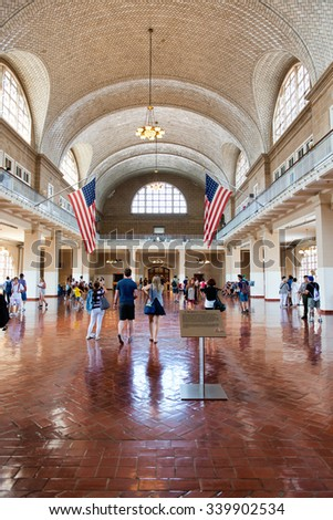NEW YORK - SEPTEMBER 02: Tourists Wandering Through Great Hall of Ellis Island Immigration Museum - Historic Location Where New Immigrants Were Processed - New York City, USA. September 02, 2015. - stock photo
