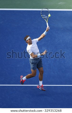 NEW YORK- SEPTEMBER 7, 2013: Twelve times Grand Slam champion Rafael Nadal in action during his semifinal match at US Open 2013 against Richard Gasquet at Arthur Ashe Stadium in Flushing, NY - stock photo