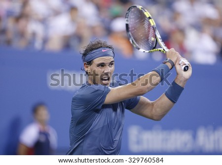 NEW YORK- SEPTEMBER 2, 2013: Twelve times Grand Slam champion Rafael Nadal in action during his fourth round match at US Open 2013 against Philipp Kohlschreiber at Arthur Ashe Stadium in New York - stock photo