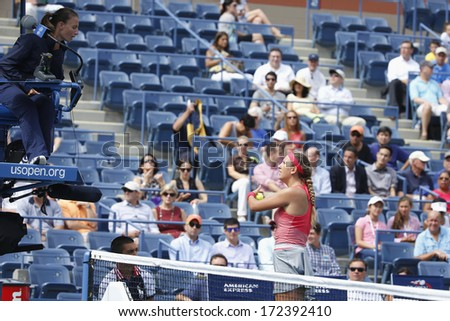 NEW YORK - SEPTEMBER 3 Two times Grand Slam champion Victoria Azarenka argues with chair umpire during quarterfinal match at US Open 2013 at Arthur Ashe Stadium on September 3, 2013 in New York - stock photo