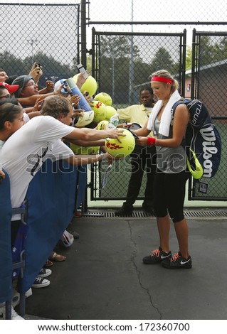 NEW YORK - SEPTEMBER 1 Two times Grand Slam champion Victoria Azarenka signing autographs after practice for US Open 2013 at Billie Jean King National Tennis Center on September 1, 2013 in New York  - stock photo
