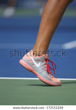 NEW YORK - September 3: Two times Grand Slam champion Victoria Azarenka wears custom Nike tennis shoes during fourth round match at US Open 2013 at Arthur Ashe Stadium on September 3, 2013 in NY - stock photo