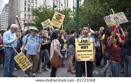 NEW YORK - SEPTEMBER 30: Unidentified demonstrators with 'Occupy Wall Street' march in Downtown Manhattan on September 30, 2011 in New York. - stock photo