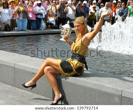 NEW YORK - SEPTEMBER 10: US Open 2006 champion Maria Sharapova holds US Open trophy in the front of the crowd after her win the ladies singles final  on September 10, 2006 in Flushing, New York. - stock photo