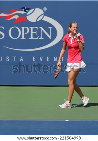NEW YORK - SEPTEMBER 7: US Open 2014 girls junior champion Marie Bouzkova from Czech Republic during final match at the Billie Jean King National Tennis Center on September 7, 2014 in New York  - stock photo