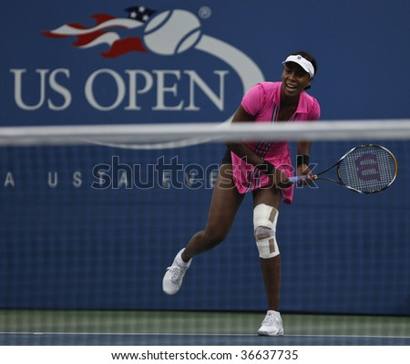 NEW YORK - SEPTEMBER 6: Venus Williams of USA returns a shot during 3rd round match against Kim Clijsters of Belgium at US Open on September 6, 2009 in New York.