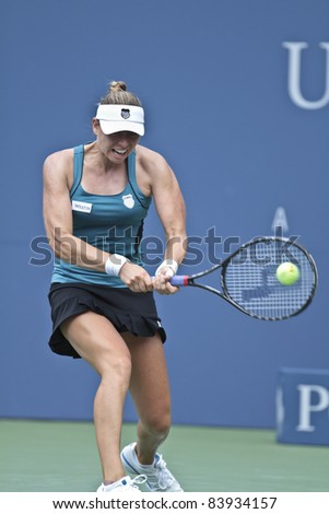 NEW YORK - SEPTEMBER 2: Vera Zonareva of Russia returns ball during 3rd round match against Anabel Medina Garrigues of Spain at USTA Billie Jean King National Tennis Center on September 2, 2011 in New York City