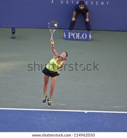 NEW YORK - SEPTEMBER 9: Victoria Azarenka of Belarus serves during final against Serena Williams of USA at US Open tennis tournament on Sep 9, 2012 in New York City
