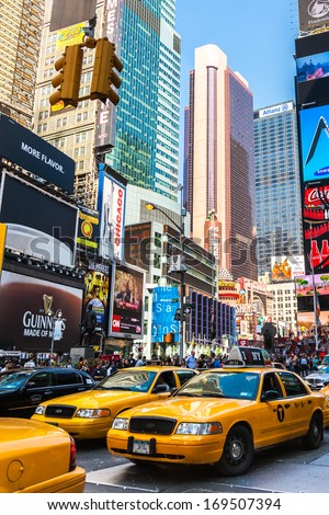NEW YORK - SEPTEMBER 20: Yellow taxis ride on the Time Square on September 20 2013 in New York, USA. Times Square is major commercial intersection and the most visited tourist attractions in NY. - stock photo