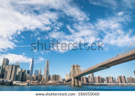 New York Skyline and Brooklyn Bridge - stock photo