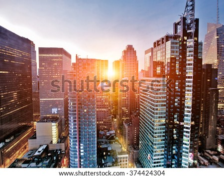 New York skyscrapers above Times Square at dawn - stock photo