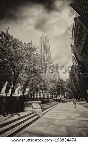 New York Skyscrapers on 5th Avenue, next to the Public Library. Beautiful Manhattan street view at sunset. - stock photo