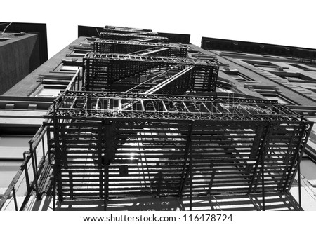 New York Stairs Fire Escape on Urban Building in Manhattan - stock photo