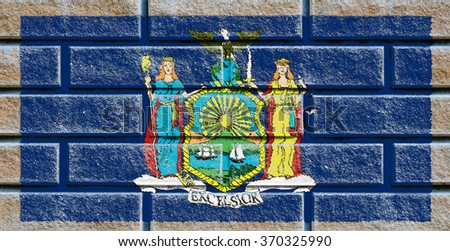 New York state flag of America on brick wall - stock photo