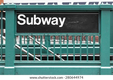 New York subway sign on green steel fence - stock photo