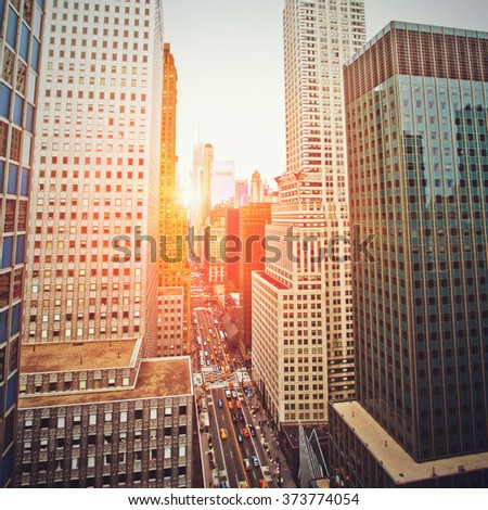 New York sunset looking down 42nd Street with Instagram filter - stock photo