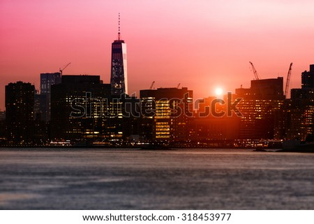 New York sunset over the East River with One World Trade Center