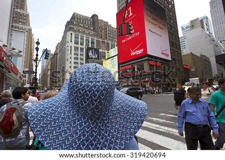 NEW YORK TOURISM - MAY 31, 2015: Home to Empire State Building, Statue of Liberty, Times Square, Metropolitan Opera, Fifth Street, Freedom Tower and more is visiting by 52 millions of tourists yearly  - stock photo