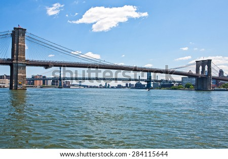 New York, U.S.A. - July 6 2009: Manhattan, the Brooklyn bridge seen from the South Street Seaport area - stock photo
