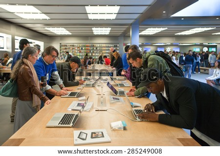 New York, U.S.A. - October 3 2010: Manhattan, Fifth Avenue, people in the Apple store - stock photo