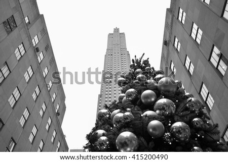 NEW YORK, UNITED STATES - DECEMBER 29, 2015 -  Christmas in New York with Christmas tree lights and decorations in the main streets of the Big Apple Rockefeller Center black and white - stock photo