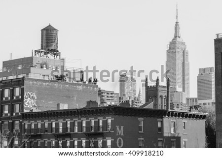 NEW YORK, UNITED STATES - DECEMBER 29, 2015 - panoramic view of the Empire State Building from The High Line park in New York were united in black and white
