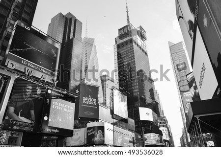 NEW YORK, UNITED STATES - DECEMBER 31, 2015 -  Street view of Times Square Skyscrapers, New York City. Times Square is a major center of the world's entertainment industry