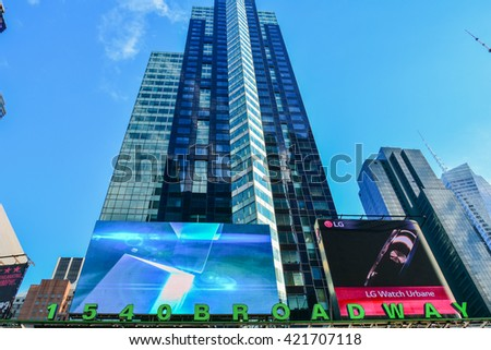 NEW YORK, UNITED STATES - DECEMBER 30, 2015 - Times Square is one of the major intersections of the New York district of Manhattan known for the large and numerous animated and digital billboards - stock photo