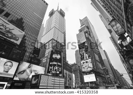 NEW YORK, UNITED STATES - DECEMBER 29, 2015 - Times Square one of the worlds busiest pedestrian intersections and a major center of worlds entertainment industry  - stock photo