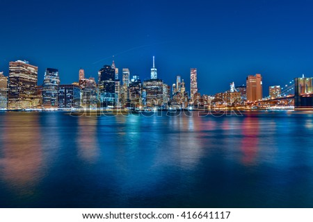NEW YORK, UNITED STATES - DECEMBER 30, 2015 - view of the downtown skyscrapers of New York at night. ND filters used to enhance colors of lights and reflections