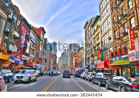 NEW YORK, UNITED STATES - FEB 6 Colorful image of a typical buildings in Chinatown's main street, New York. Chinatown has an estimated population of 100,000 people. NYC, USA, Feb 6, 2016 - stock photo
