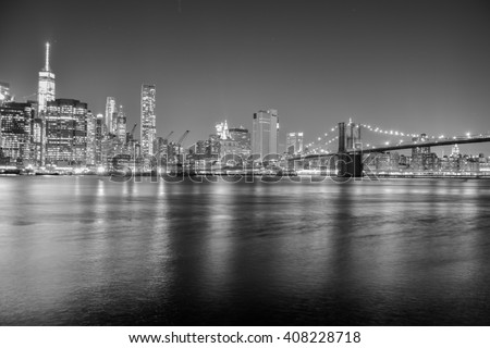 NEW YORK, UNITED STATES, JANUARY 02, 2016 - View in black and white from the Brooklyn Bridge from Manhattan skyline - stock photo