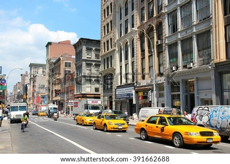 NEW YORK, UNITED STATES - JULY 4, 2013: People ride taxi cabs along West Broadway in Tribeca district, New York. Almost 19 million people live in New York City metropolitan area. - stock photo