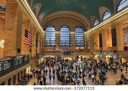 NEW YORK, UNITED STATES - JUNE 7, 2013: People hurry in Grand Central Terminal on June 7, 2013 in New York. The station exists since 1871. It had passenger ridership of 82 million in 2011.
