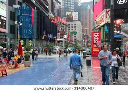 NEW YORK, UNITED STATES - JUNE 10, 2013: People visit Times Square in New York. Times Square is one of most recognized landmarks in the world. More than 300,000 people pass through Times Square daily.