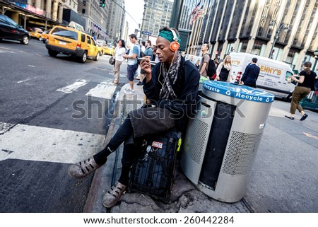 NEW YORK, UNITED STATES - SEPTEMBER 10: African american man resting near road at street of Manhattan on on September 10, 2014 in New York, USA