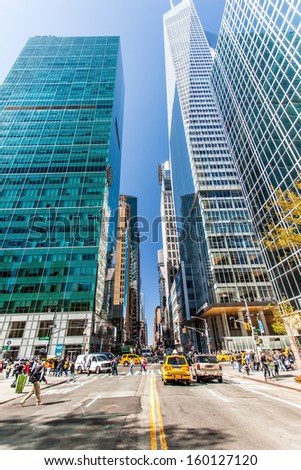 New York, United States - September 24, 2013: People are crossing the line over the street at the Bryant Park Corner under the skyscraper. - stock photo