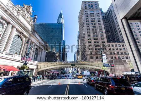 New York, United States - September 24th, 2013. Gran Central Terminal facade on 42nd street in New York City. The Grand Central Hyatt hotel and Empire State building can be seen in the distance. - stock photo