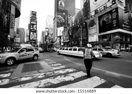 NEW YORK - UNKNOWN: A NYC traffic officer directs traffic in this undated image taken in New York City's Times Square area.