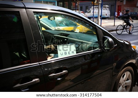 New York, US - 29 August 2015. Uber car service on the streets of New York - stock photo