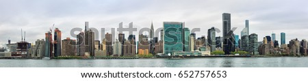 NEW YORK, USA - Apr 27, 2016: Manhattan, NYC. Panoramic view of Midtown skyline and the United Nations headquarters. View from Queens over the East River