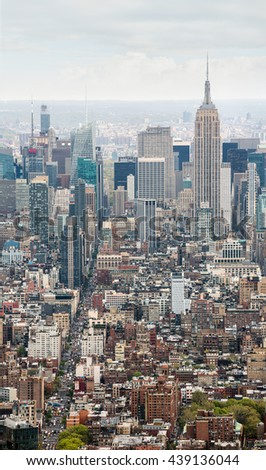 NEW YORK, USA - Apr 28, 2016: 6th Ave and Empire State Building. Sixth Avenue officially Avenue of the Americas is a major thoroughfare in New York City - stock photo