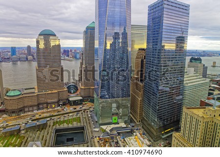 NEW YORK, USA - APRIL 23, 2015: Aerial view of National September 11 Memorial - 9/11 - in Financial District in Lower Manhattan. It is a commemoration of the terrorist attacks on September 11, 2001    - stock photo