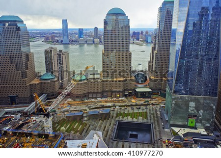 NEW YORK, USA - APRIL 23, 2015: Aerial view of National September 11 Memorial - 9/11 - of Financial District in Lower Manhattan. It is a commemoration of the terrorist attacks on September 11, 2001 - stock photo