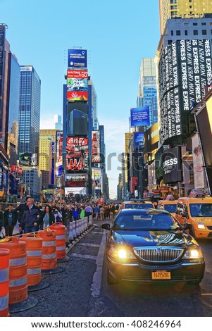 New York, USA - April 26, 2015: Busy Traffic and tourists on Broadway and 7th Avenue in Times Square. Skyscrapers in Midtown Manhattan in New York, USA. - stock photo