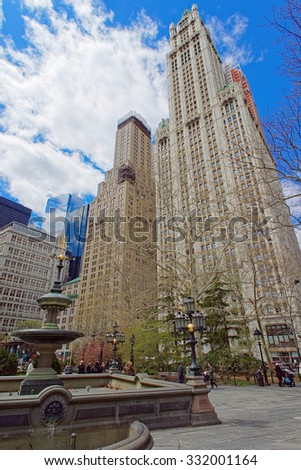 NEW YORK, USA - APRIL 24, 2015:  City Hall Park fountain in Manhattan, New York City, USA. This 8.8-acre downtown park is home to more than a dozen monuments                  - stock photo