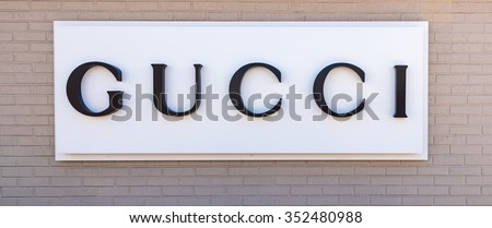 NEW YORK,USA-APRIL 9,2015:Gucci store with its signage on facade.Gucci is an Italian fashion and leather goods brand, part of the Gucci Group, which is owned by the French holding company Kering. - stock photo