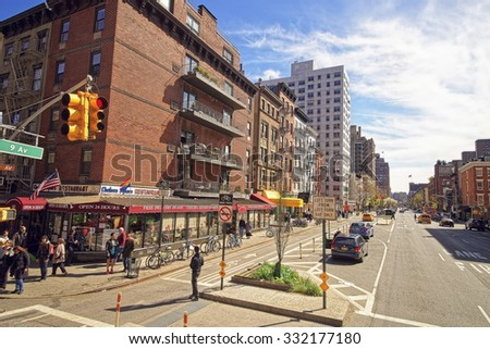 NEW YORK, USA - APRIL 24, 2015: Semi-deserted Ninth Avenue aka Columbus Avenue is southbound thoroughfare on West Side of Manhattan in New York City, USA.                          - stock photo