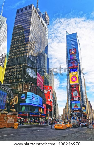 New York, USA - April 26, 2015: Skyscrapers and tourists in Times Square on Broadway and 7th Avenue in Midtown Manhattan in New York, USA. It is a commercial junction of Broadway and 7th Avenue - stock photo